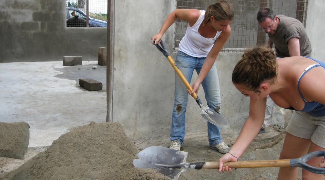 Construction volunteers in Ghana building classrooms.